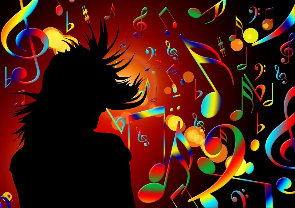 カラフルな音符とダンサーのシルエット